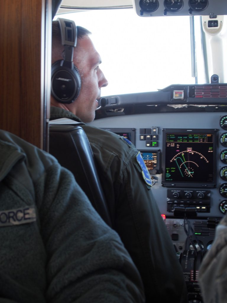 Air Force pilot of a C-12 flying from Elmendorf to Cape Romanzof (Photo by Zachariah Hughes, Alaska Public Media - Anchorage)