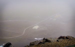 A faint view of the lower site from the radar station atop a defunct volcano. (Photo by Zachariah Hughes, Alaska Public Media - Anchorage)