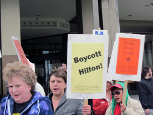 Protestors assemble outside the Hilton Hotel in Anchorage in August 2011. Photo by Ellen Lockyer, KSKA - Anchorage