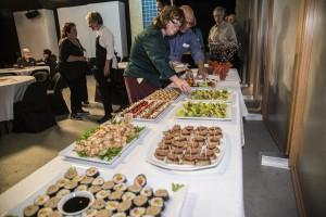 VIP Guests enjoy Rick Steve's meet and greet in Alaska Public Media's studios. Photograph by Michael Conti.