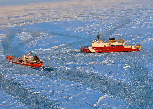 Photo courtesy of the US Coast Guard: The Coast Guard Cutter Healy approaches the Russian-flagged tanker Renda while breaking ice around the vessel 97 miles south of Nome, Alaska, Jan. 10, 2012.