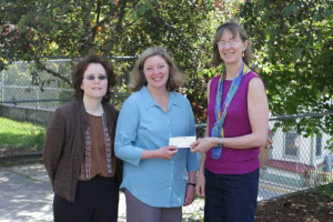 Talitha Lukshin and Rachel Sanders, Haven House Board Members, accept a donation from Amy Skilbred, Juneau Community Foundation Executive Director, from the Machamer Fund.
