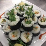 Muktuk sushi roll topped with Alaska Sprouts grown in Anchorage made by Chef Rob Kineen.