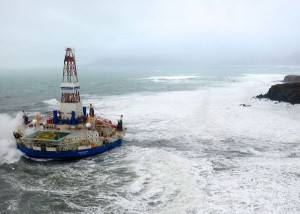 The conical drilling unit Kulluk sits aground on the southeast shore of Sitkalidak Island about 40 miles southwest of Kodiak City, Photo courtesy of the U.S. Coast Guard.