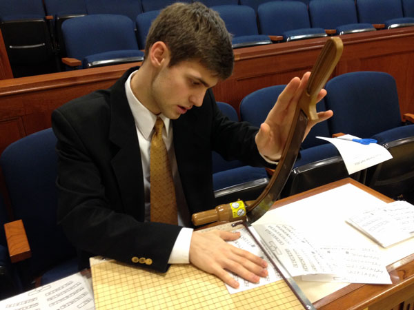 A page hard at work in the House Chamber. Photo by Annie Feidt, APRN - Anchorage.