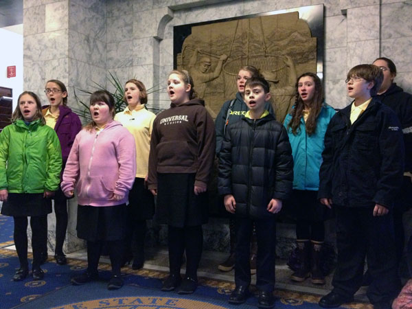 The Alaska Youth Choir warming up for the opening House and Senate session Tuesday. Photo by Annie Feidt, APRN - Anchorage.