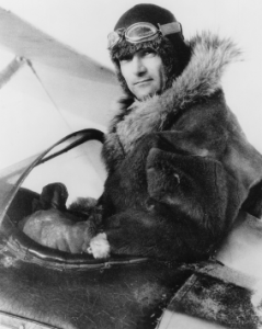 Harold Gillam, in the cockpit of his ski-equipped Waco.