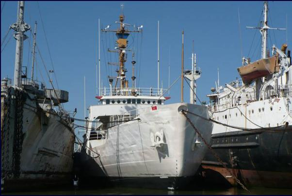The retired USCGC Storis (middle) sits in storage at the National Defense Reserve Fleet shipyard at Suisun Bay, California. Photo courtesy Storis Museum and Educational Center.