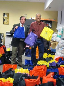 Wasilla Mayor Verne Rupright  (l) and Mat - Su Coalition on Housing and Homelessness Director Dave Rose (r) stand with bags of supplies for homeless  at Wasilla's Project Homeless Connect event on Jan. 30. Photo by Ellen Lockyer, KSKA - Anchorage.