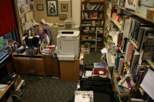 Library Director Sarah Bell works in her crowded office at Kettleson Memorial Library, in this September 2012 file photo. Her office has become defacto storage for a lot of equipment, something an upcoming expansion of the library aims to correct.