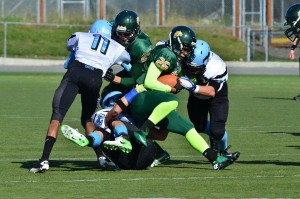 Chugiak and Service High School football players collide during the 2012 season. Photo courtesy of the Chugiak High School Football Booster Club.