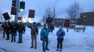 Union supporters rally in protest of AO37 outside an Assembly meeting in February.
