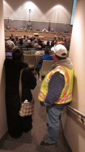Union supporters watch as the Assembly deliberates passing Mayor Dan Sullivan's controversial labor ordinance. Photo by Daysha Eaton, KSKA - Anchorage.