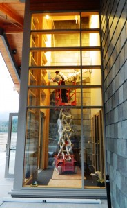 Rich Stage bolts a scuplture he and Evon Zerbetz created for the Ketchikan Public Library entryway. Photo from KRBD - Ketchikan.
