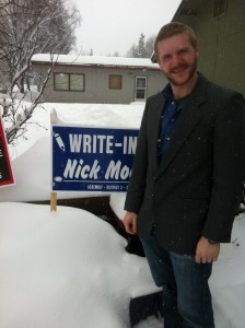 Nick Moe stands beside a campaign sign in his yard at his home in 'Old Spenard'.