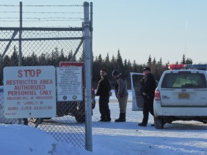 Leroy B. Dick, Jr., 42, in custody at the Dillingham airport. Dick is facing first degree murder charges for the killing of Manokotak VPSO Thomas Madole. Photo by Jason Sear, KDLG - Dillingham