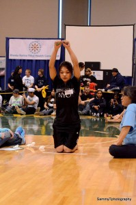 Apaay Campbell, a 16-year-old from Gambell, competes in the kneel jump at the Native Youth Olympics in Anchorage. Photo courtesy of Sammy T Photography.