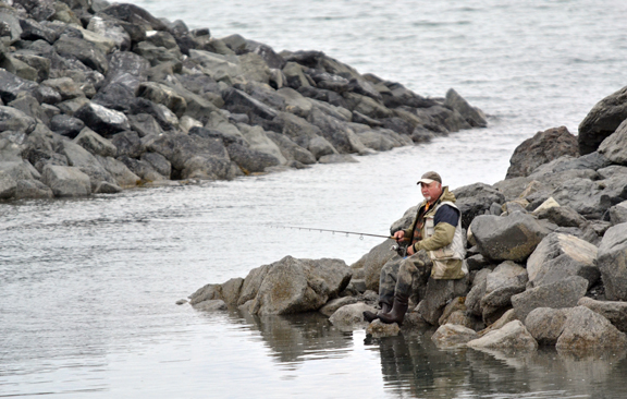 An angler fishes the outgoing tide for king salmon at the Homer Fishing Hole, aka Nick Dudiak Lagoon, before the start of the 2011 Memorial Day weekend.