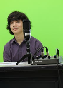 Kenny Petrini preparing for Friday morning announcements at Central Middle School.  Photo by Alexander Duerre.