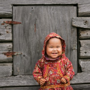 Young Yup'ik girl, Shaylene Spein, in traditional kuspuk, Kwethluk, Alaska.