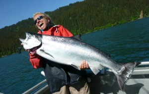 Visiting Minnesotan Rebecca Lundberg hoists the 28-lb. white feeder king she caught Saturday, June 23, 2012, in Kachemak Bay.