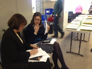 Municipal clerk Barbara Jones (left) and Deputy Clerk of Election Amanda Moser discuss procedures for counting question ballots.