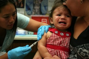 Annabelle, 1, gets an immunization for pertussis at a community health center in Richmond, California. (Photo by Anne Brice/KCAW)