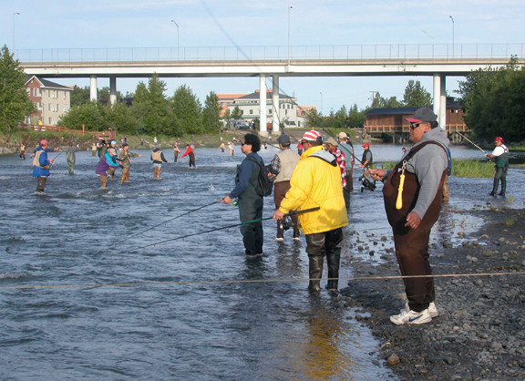 Combat fishermen line the banks where Ship Creek's great run of king salmon then run the gauntlet in 2007.