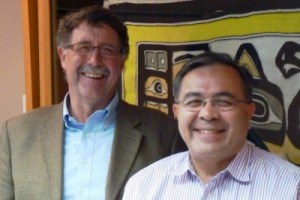Sealaska CEO Chris McNeil, right, poses with Vice President Rick Harris at the corporation's board room. Photo by Ed Schoenfeld, CoastAlaska News.