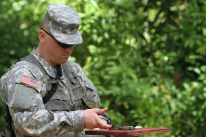 Sgt. Daniel S. Alsdorf orients himself with his compass during the land navigation course as part of the Pacific Army Reserve Best Warrior Competition, May 19. Photo by Army Staff Sgt. Joseph Vine.