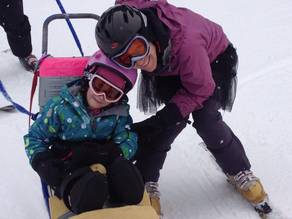 Leah and her daughter Anna downhill skiing with Challenge Alaska.