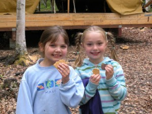 Girls enjoying s'mores at Camp Togowoods near Wasilla.