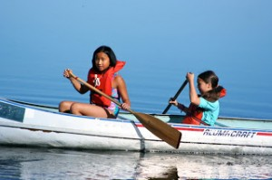 At Camp Togowoods, girls not only learn how to paddle but also how to right an overturned canoe.