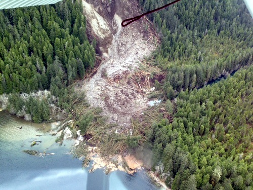 The path of a 2013 landslide shows destruction and debris left from where a Forest Service cabin used to stand.