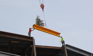 Workers lower the final piece of structural steel into place at the Alaska Airlines Center on the UAA campus. Photo by Josh Edge, APRN - Anchorage.