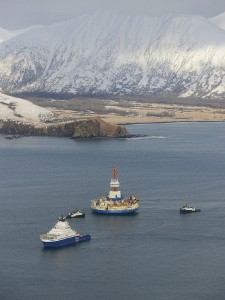 The drilling unit Kulluk, towed by the anchor-handling vessel Aiviq, heads to its safe harbor location in Kiliuda Bay. Photo courtesy of Shell Alaska.