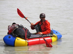 Luc in his pack raft.
