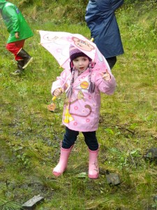 A young rainboot racer tests her pink raingear before Saturday's race.