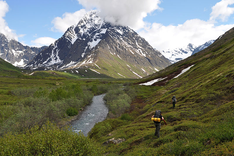 Walking into the upper reaches of the Peters Creek backcountry, below Mount Rumble. Chugach Mountains, Alaska. By Paxson Woelber. Creative Commons Attribution-Share Alike 3.0 Unported license