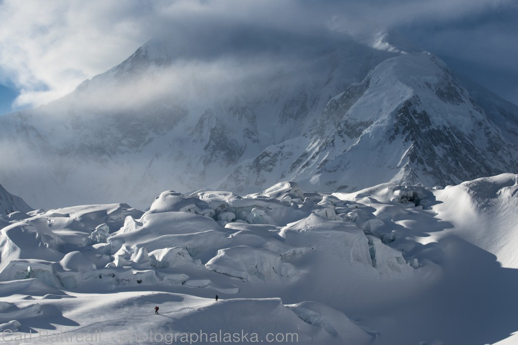 Skiers and the Kahiltna Icefall. Photo by Carl Battreal. www.photographalaska.com.