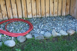 Rocks help block a fire from spreading. Photo by Sara Bernard, APRN-Anchorage.