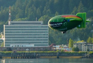 A Greenpeace airship promoting the group's Bering Sea Canyons protection initiative sails over Juneau's Gastineau Channel Saturday evening. Photo by Ed Schoenfeld, CoastAlaska News.