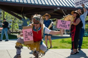 John Smith the 3rd dances with protest signs at the Idle No More rally at Marine Park. (Photo by Heather Bryant/KTOO)