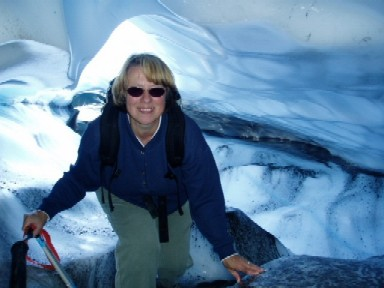Kris Crossen standing inside an ice cave on the Bering Glacier.