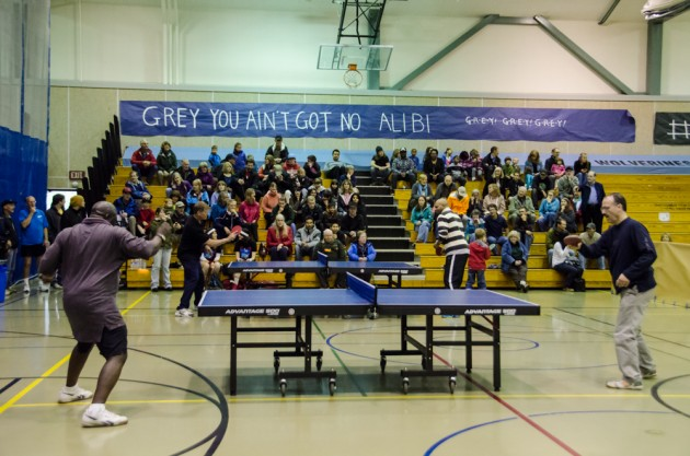 Fred Ssessanga plays against Will Shortz (front) while Tim McCloud plays Robert Roberts (back) at the Dzantik'i Heeni Middle School Gym. (Photo by Heather Bryant/KTOO)