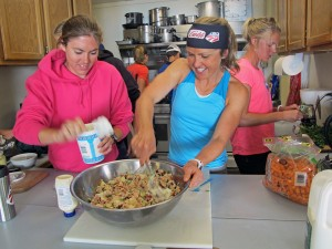 Olympian Holly Brooks and a teammate prepare a meal during the camp. (Photo by Annie Feidt, APRN - Anchorage)