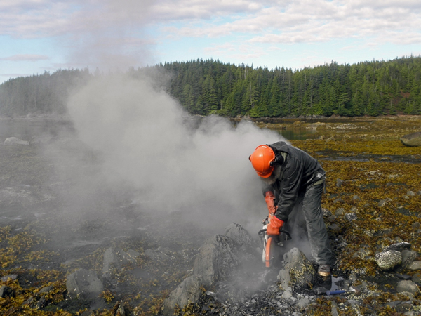 Jim Baichtal uses a special chainsaw to carefully remove fossils from rocks on Gravina Island.
