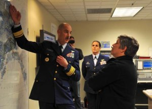 Rear Adm. Thomas Ostebo, commander District 17, explains Coast Guard operations in the Arctic and the distances covered by Coast Guard assets throughout Alaska to Secretary of Homeland Security Janet Napolitano, Monday, Aug. 5, 2012. Courtesy, by Petty Officer 3rd Class Jonathan Klingenberg.