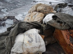 2013 Muldrow cleanup, US Military sleeping bag and debris from 1947 camp