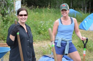 Candace Winkler and Jessie Menkens take a break from their work.